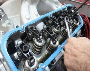 Rocker arms and valve adjustment
