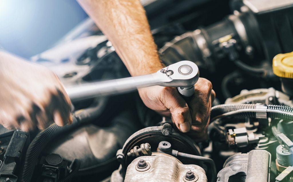 Man Repairing Car Engine