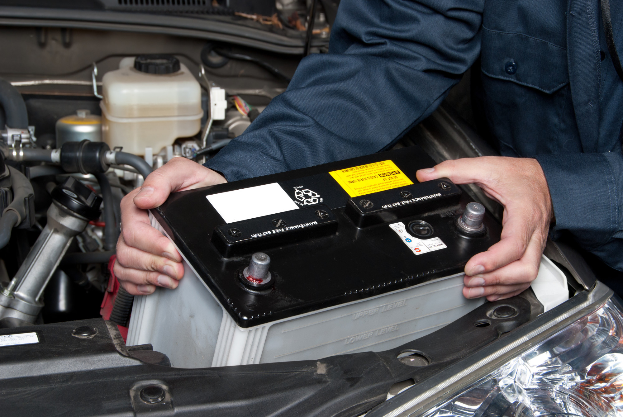 Mechanic Placing a Car Battery