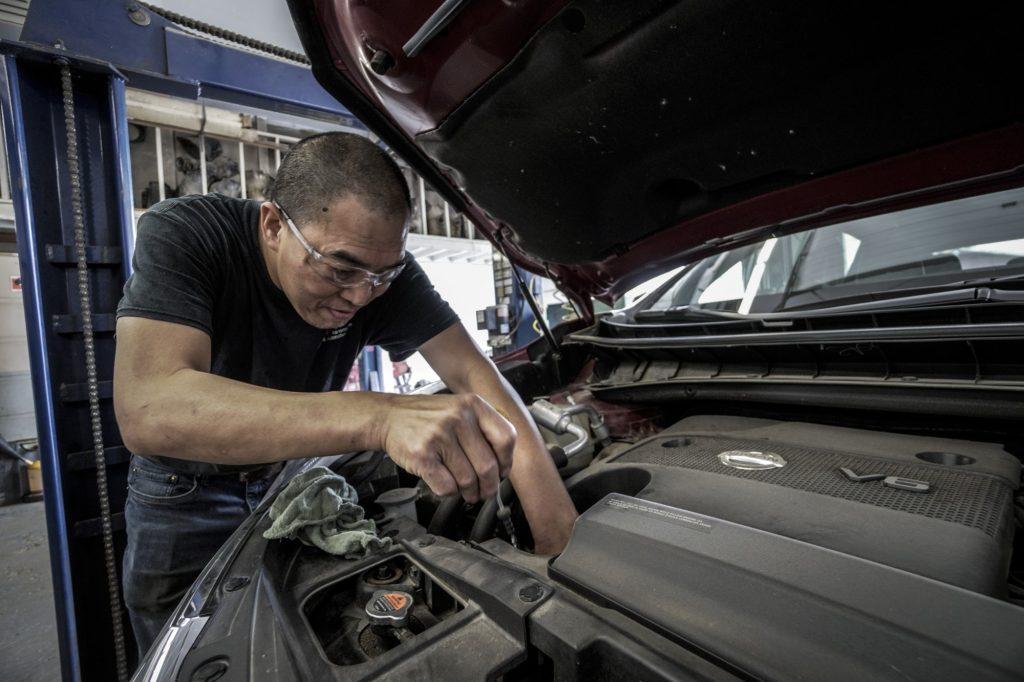 Man Checking Car Engine